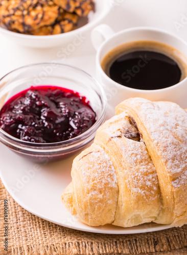 In de dag Milkshake Breakfast with coffee, jam, cookies and croissants on table
