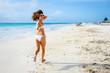 Playful woman having fun on tropical beach vacation