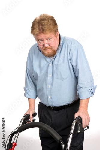 Fotografie, Obraz  Old Man Using Walker