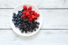 Raspberries, Blackberries, Blueberries On A Plate