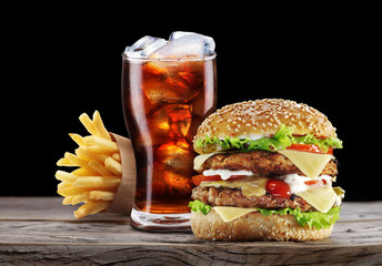 Fototapeta Do steakhouse Hamburger, potato fries, cola drink. Takeaway food.
