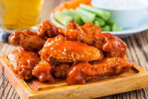 Staande foto Buffel Buffalo chicken wing with cayenne pepper sauce