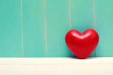 Red Shiny Heart On Vintage Tea...