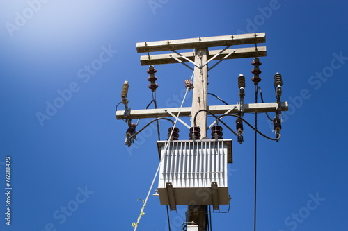 electrical post with power line cables on blue sky buy this stock