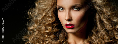 Beautiful woman with magnificent curly hair. Red lipstick.
