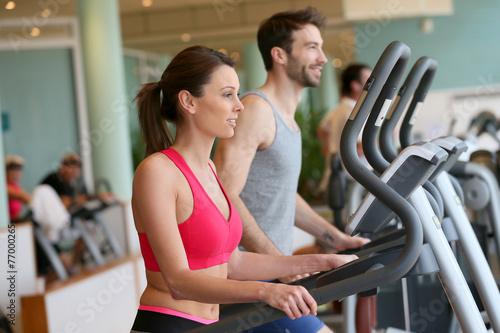 Fotografie, Obraz  Couple doing cardio training program in fitness center