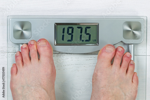 Fotografie, Obraz  Checking Body Weight on Scale