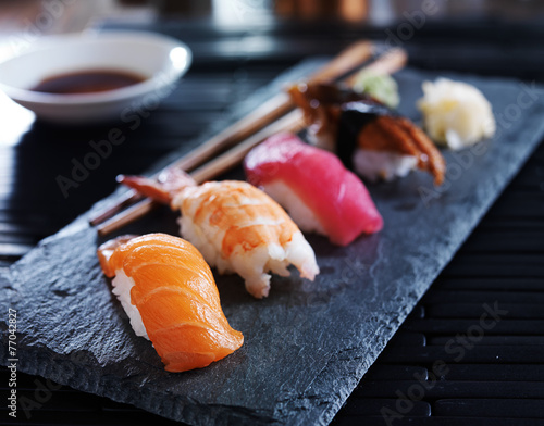 Poster Sushi bar assorted sushi nigiri on slate