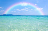 Fototapeta Tęcza - Colorful rainbow over a Tropical beach of Andaman Sea, Thailand