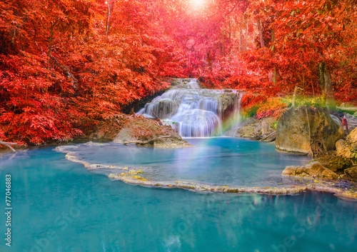 Poster Cuban Red Wonderful Waterfall with rainbows in deep forest at national par