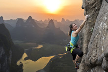 Female Climber Against Sunset ...