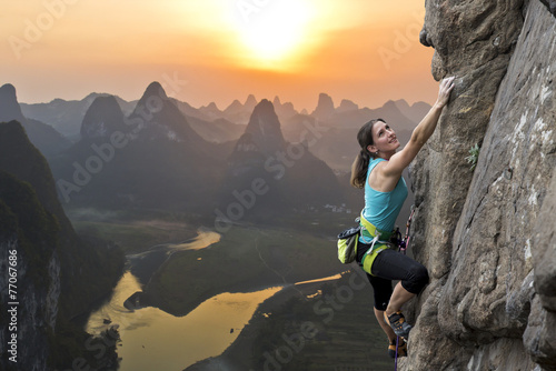 Fotografie, Obraz  Female climber against sunset at Li River