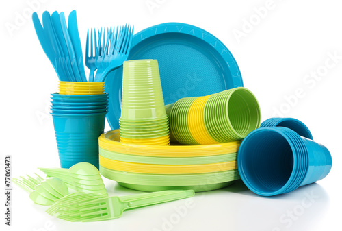 Fotografía  Bright plastic disposable tableware isolated on white
