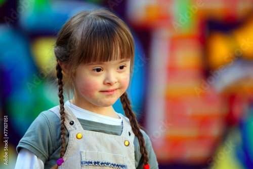 Portrait of beautiful young girl on the playground. Canvas Print
