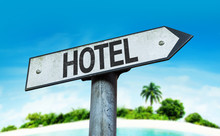 Hotel Sign With A Beach On Bac...
