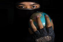 Terrorist Hold Globe In Hand.
