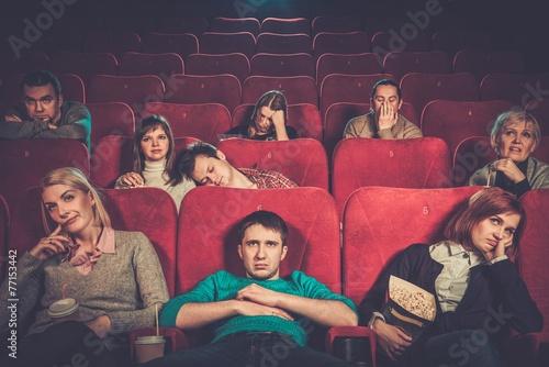 Stampa su Tela Group of people watching boring movie in cinema
