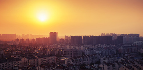 Bright colorful sunrise over big city panorama. Vintage toned