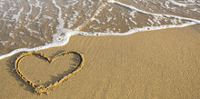 Heart Drawn On Ocean Beach Sand.