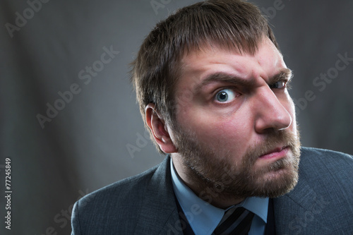 Fotografering  Curious  businessman