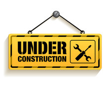 Under Construction Sign In Whi...