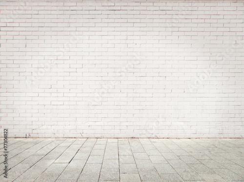 Tuinposter Baksteen muur room with white bricks wall and gray floor