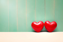 Red Shiny Hearts On Vintage Teal Wood
