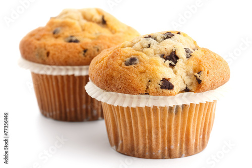 Fotografie, Obraz  Two light chocolate chip muffins in wax liner on white.