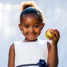 Cute African Girl Holding Apple.