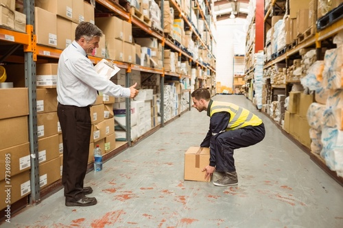 Fotografie, Obraz  Manager watching worker carrying boxes