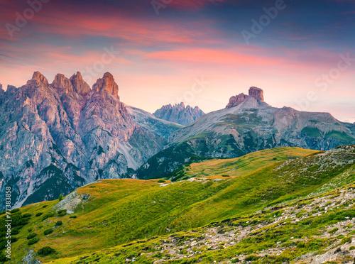 Foto op Aluminium Zalm Colorful sunrise on the Piana mountain range