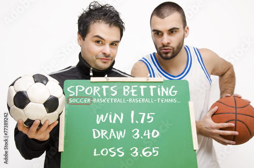 Fotografía  Sports betting athletes holding blackboard with odds