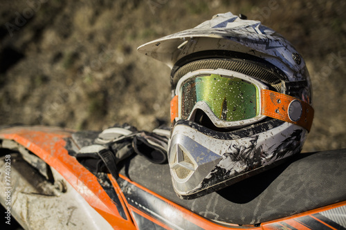 Photo  Dirty motorcycle motocross helmet with goggles