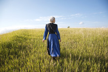 Amish Woman In Blue Dress And ...