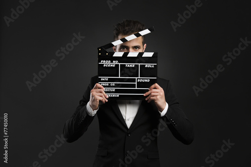 Fotografia  Business man holding a clapboard