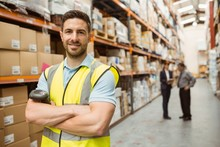 Smiling Worker Standing With Arms Crossed