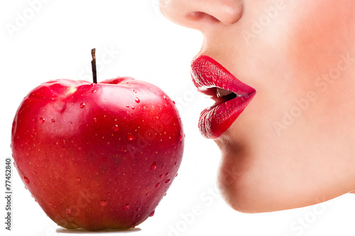 Fotografija  sexy woman eating red apple, sensual red lips