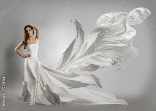 Fotografija  beautiful young girl in flying white dress. Flowing fabric