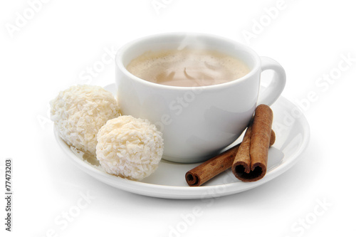 Fotografia, Obraz  cup of coffee with chocolate candies and cinnamon