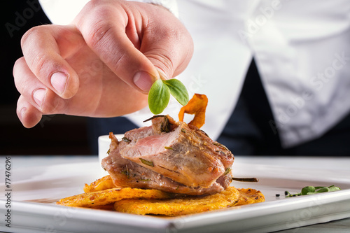 Fototapeta Chef in hotel or restaurant kitchen cooking, only hands. obraz