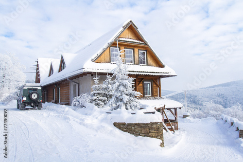 Plakat  Mountain cottage in winter.  Beskids Mountains, Poland