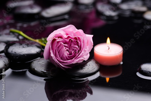 Fotobehang Spa Beautiful lying down rose with candle and therapy stones