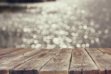 Wood Board Table In Front Of Summer Landscape Of Sparkling Lake