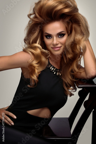 Hair volume.  Portrait of beautiful Blonde with Long Wavy Hair. Canvas