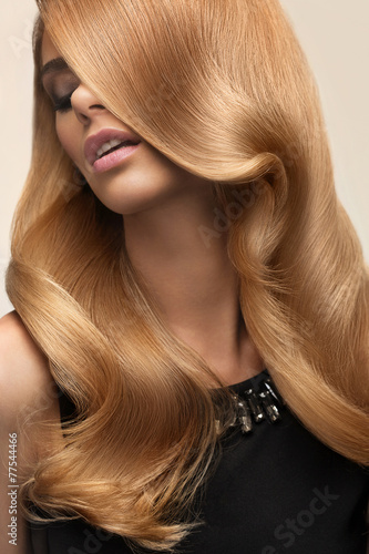 Blond hair. Portrait of beautiful Blonde with Long Wavy Hair. Hi Plakat
