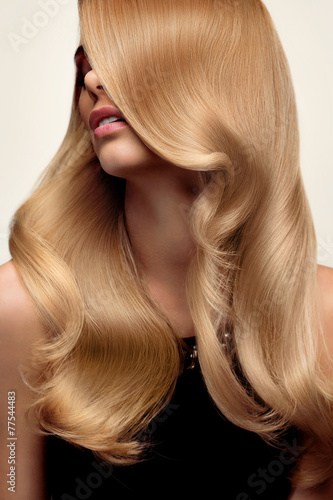 Blond hair. Portrait of beautiful Blonde with Long Wavy Hair. Hi Poster