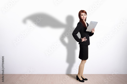 Photo  Superhero Business Woman with tablet