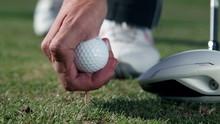 Golfer Sticks A White Golf Ball On The Special Holder