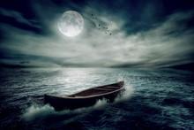 Boat Drifting Away On Moonligh...
