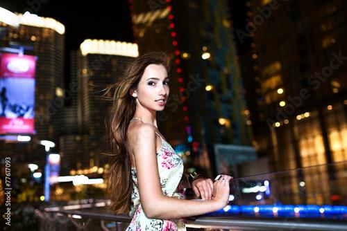 Fotobehang Las Vegas Happy girl with windy hairs at night lights of Las Vegas